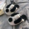 pantoufle chien blanc et noir